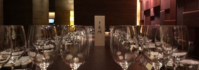 Tatenokawa's Komyo 1% polished sake placed on a table at London' ROKA restaurant